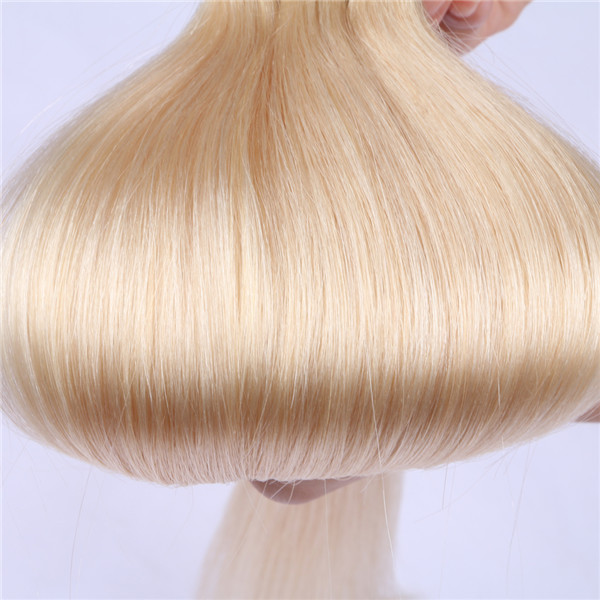 Bleach blonde tape in hair extensions XS092